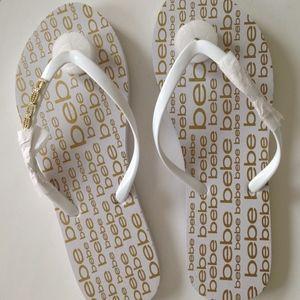 bebe Samirah Sparkly Logo White Gold Flip Flops